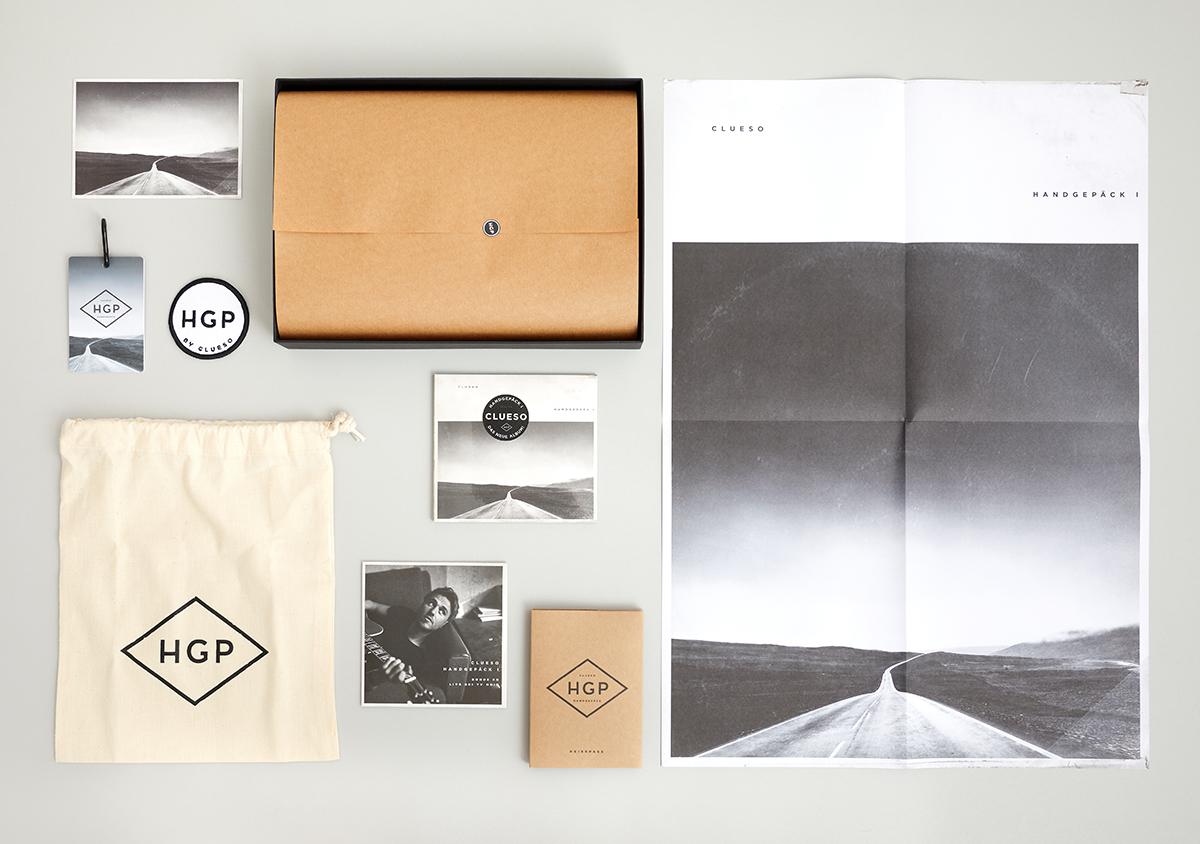 Clueso Handgepaeck 1 Album Fanbox Postkarte Anhaenger Aufnaeher Logo Beutel Bonus-CD Digipak Reisepasshuelle Poster